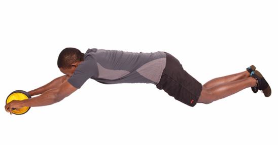 Fitness Man Doing Ab Wheel Roller Abdominal Exercise Kneeling