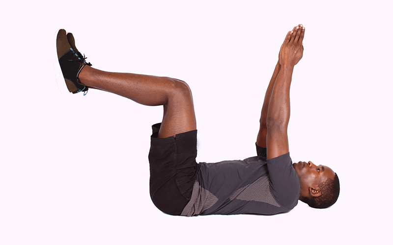 Man Lying on Back Lifting Hands and Legs