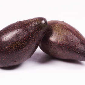 Two Big Black Avocados With White Background
