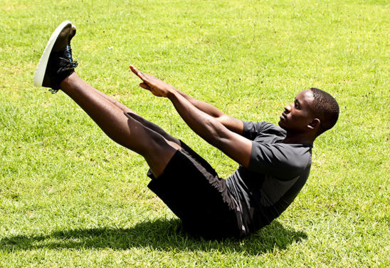 A Man Doing V Ups Ab Exercise Outdoors