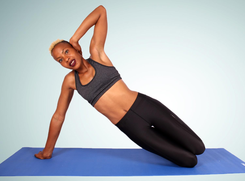 Athletic Woman Doing Knee Side Plank Beginner Exercise