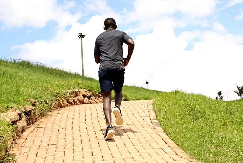 Athletic Young Man Jogging in A Park