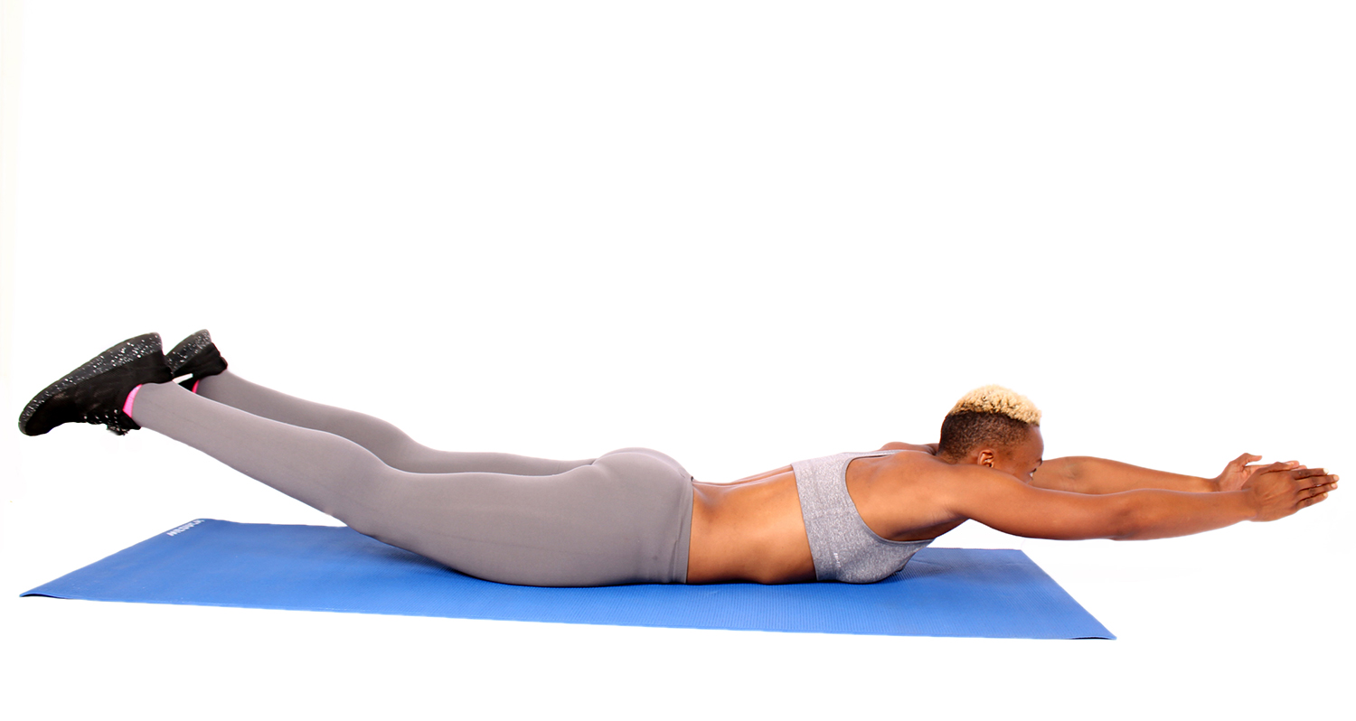 Fit Woman Doing Superman Exercise For Core and Lower Back