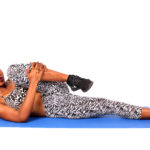 Woman Stretching Hamstring Muscles On The Floor