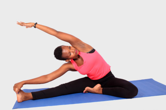 Athletic woman stretching and doing yoga