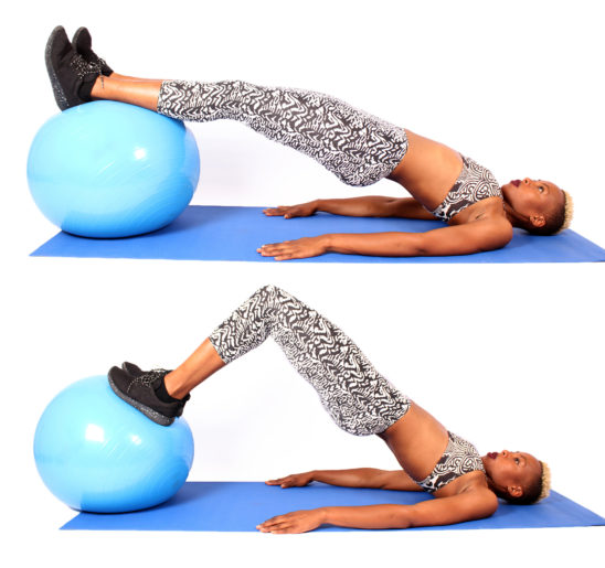 Athletic Woman Doing Glute Bridges on Swiss Ball