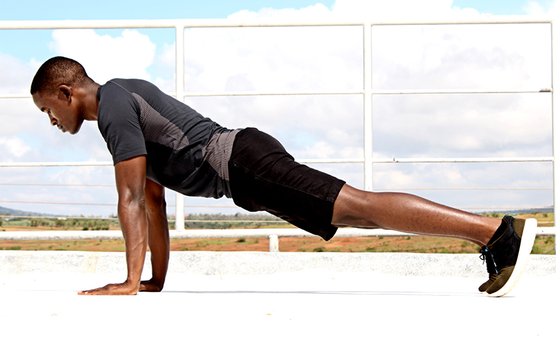 Exercise Man Doing Push Ups Outdoors on Sunny Day