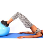 Fit Woman Doing Glute Bridges on Swiss Ball to Tone Butt Muscles