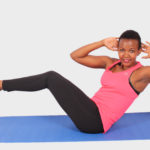 Smiling Woman Doing Abdominal Exercise With Shoulders and Legs Raised