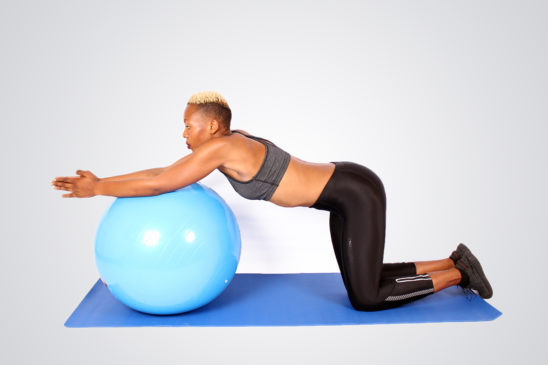 Woman Exercising and Stretching on Swiss Ball