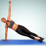 Sporty Woman Doing Side Plank Yoga Pose