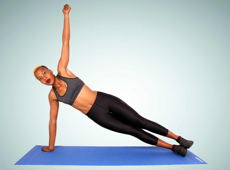 Sporty Woman Doing Side Plank Yoga Pose