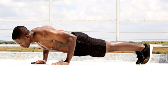 Fitness Man Doing Push Ups To Build Muscles