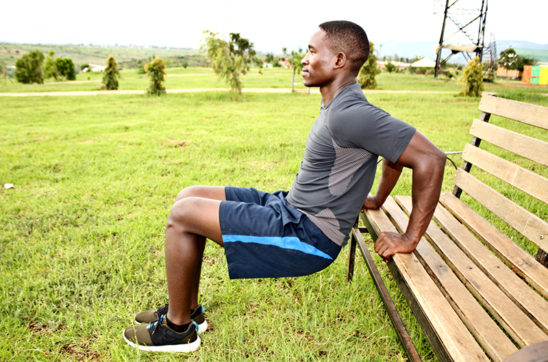 Fitness Man Doing Triceps Bench Dips Outdoors