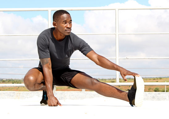 Fitness Man Stretching His Legs Before Workout