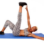 Fitness Woman Doing Toe Touch Ab Exercise