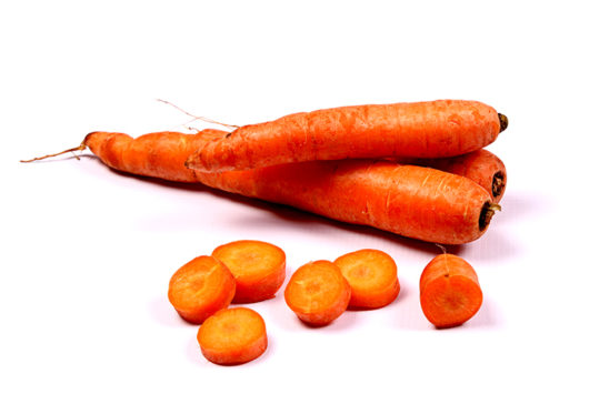 Fresh Carrots and Cut Pieces on White Background