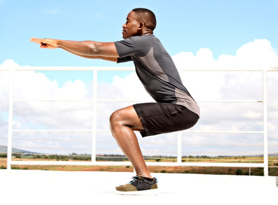 Man Doing Bodyweight Air Squats Outdoors