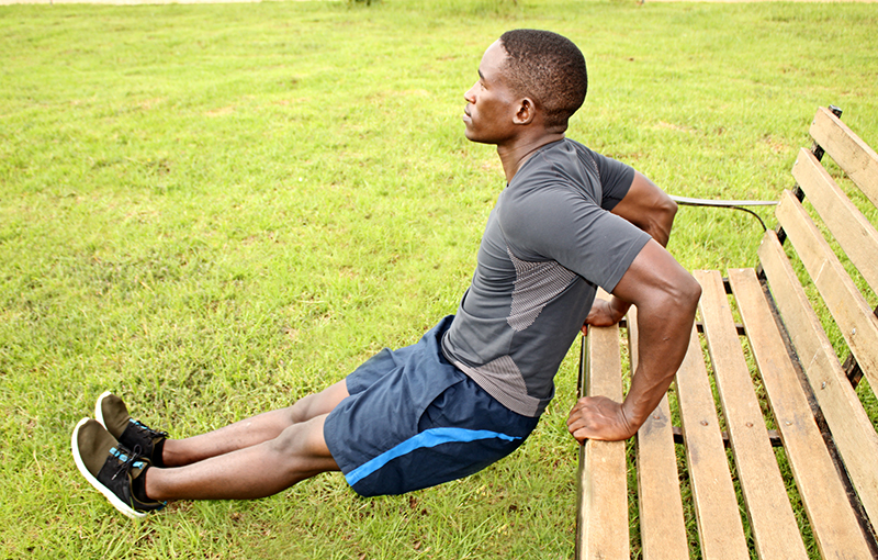 Man Doing Triceps Bench Dips Outdoors