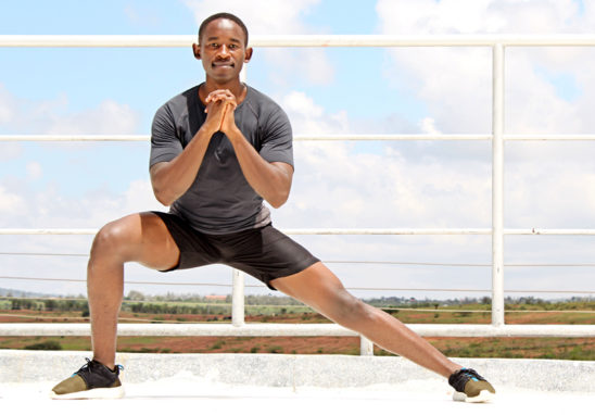 Man Working Out Doing Side Lunges Outdoors