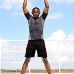 Muscular Athlete Doing Jumping Jacks Outdoors