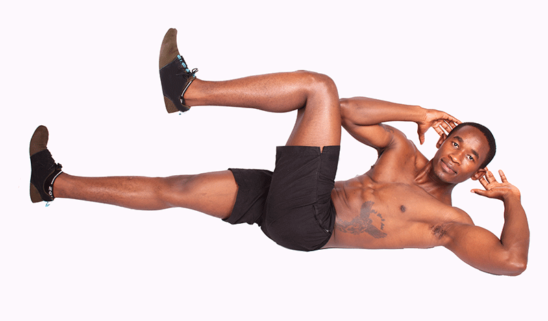 Muscular Man Doing Bicycles Crunches Ab Exercise on White Background