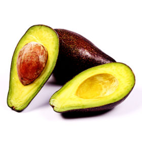 One Avocado and Two Slices on White Background. Healthy Food Concept
