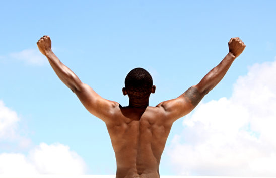 Shirtless Fit Man Raising Hands Up Sky