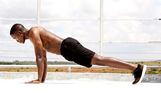 Shirtless Muscular Man Doing Push Ups Outdoors