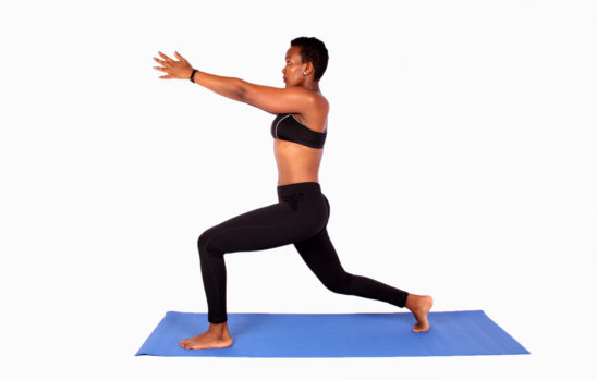 Fitness Woman Practicing Yoga in Forward Lunge Position