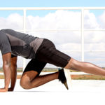 Smiling Man Doing Mountain Climbers Exercise Outside
