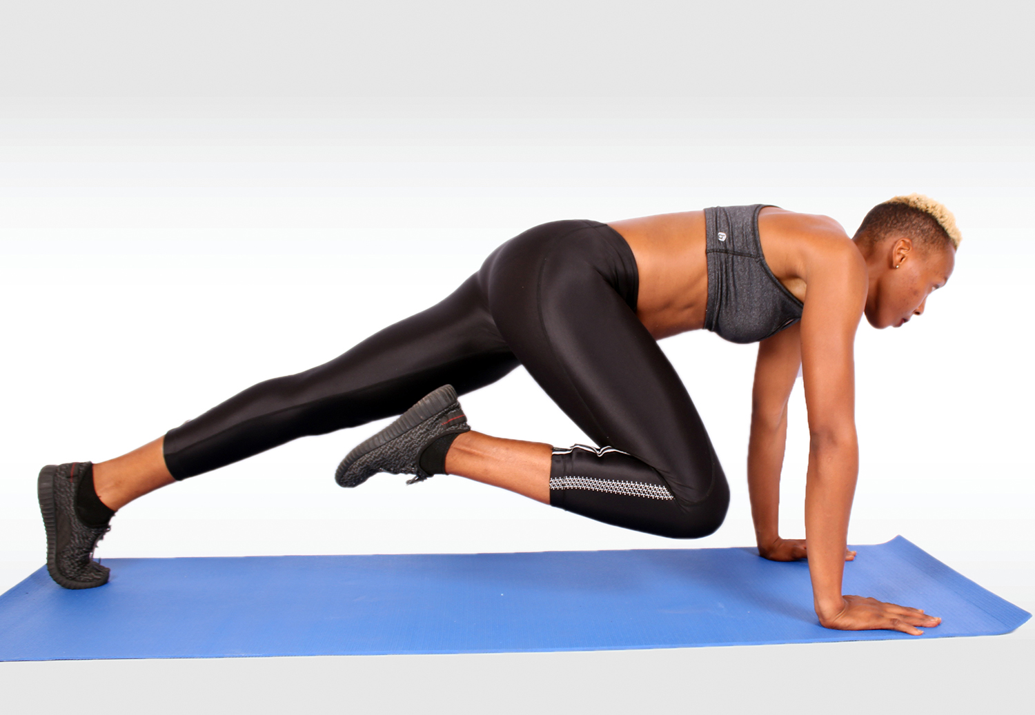 Athletic Woman Doing Mountain Climbers Ab and Core Exercise