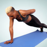 Strong Woman Doing One Arm Push Ups on Yoga Mat