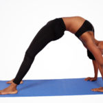 Flexible Man Doing Yoga Back Bridge Pose on Blue Yoga Mat