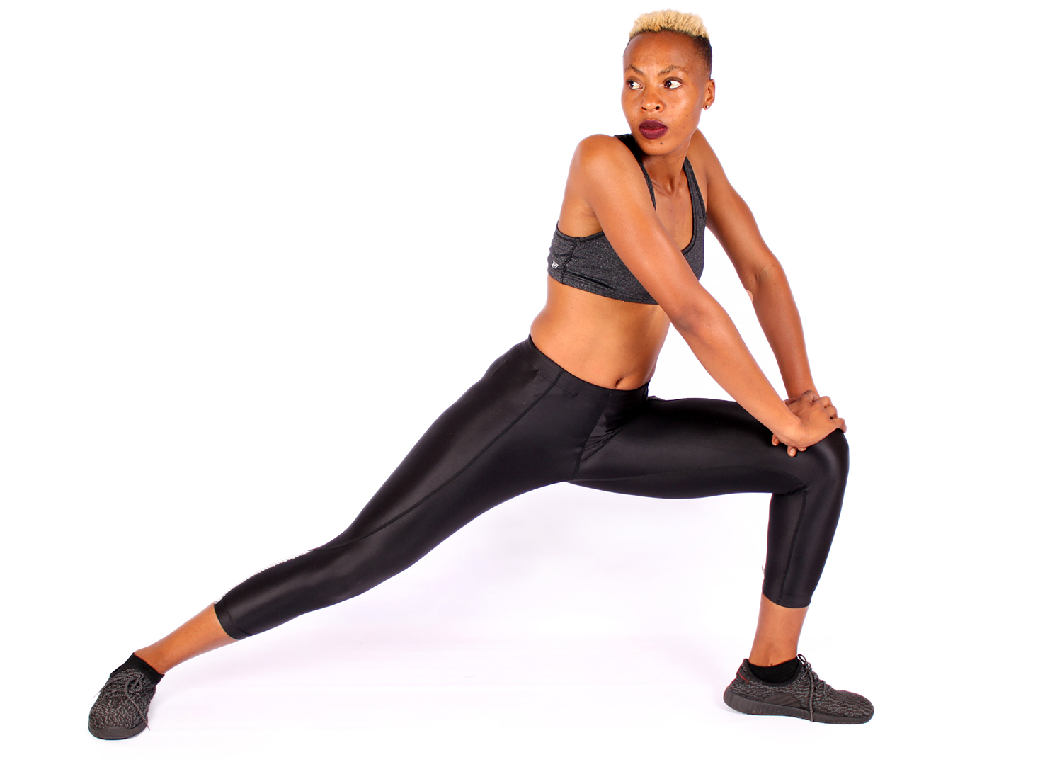 Slim Woman Stretching Legs in Side Lunge Position