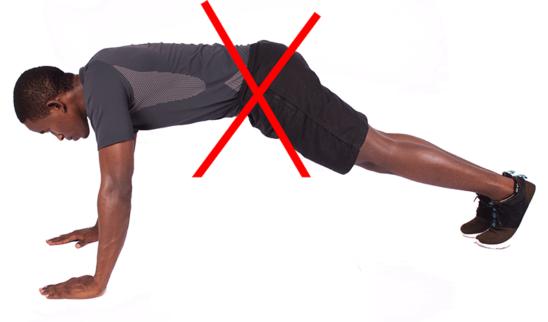 Wrong Push Ups. Man Lifting Butt Up Doing Push Ups