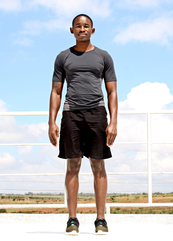 Young Athletic Black Man Standing Outside Ready to Exercise