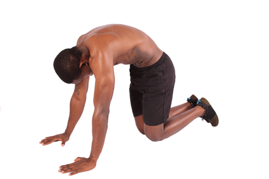 Young Man Doing Yoga Stretch For Back Pain