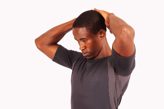 Young Man Stretching Neck Forward to Relieve Neck Pain