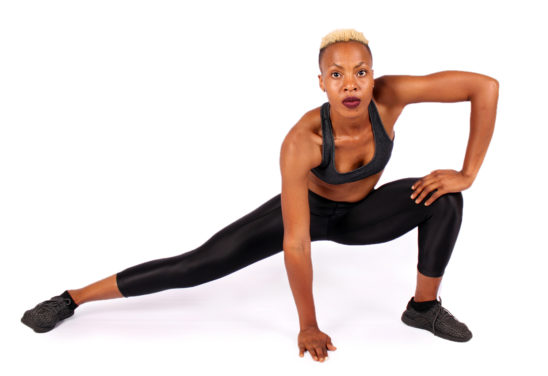 Woman Stretching Legs With Side Lunge Hamstring Stretch