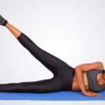 African Woman Doing Lying Side Leg Raises on Yoga Mat