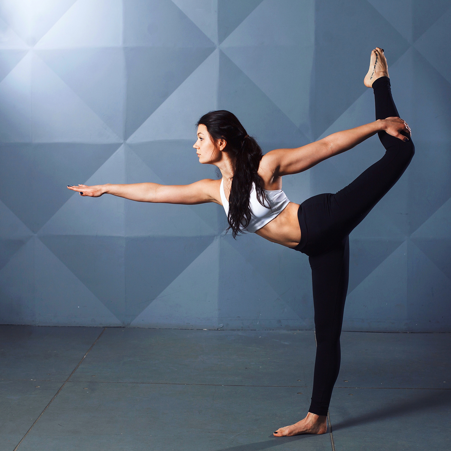 Flexible Yogi Doing The Dancer's Pose. Balancing Yoga Pose