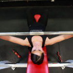 Strong Woman Doing Barbell Bench Press