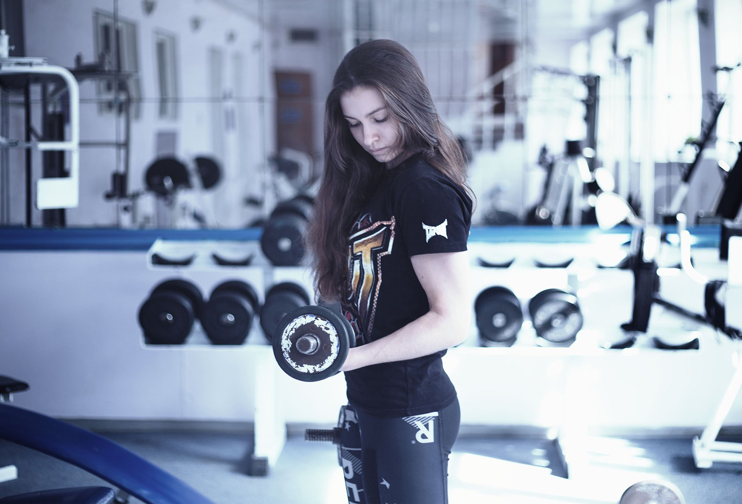 Beautiful Girl Doing Bicep Curls With Dumbbells