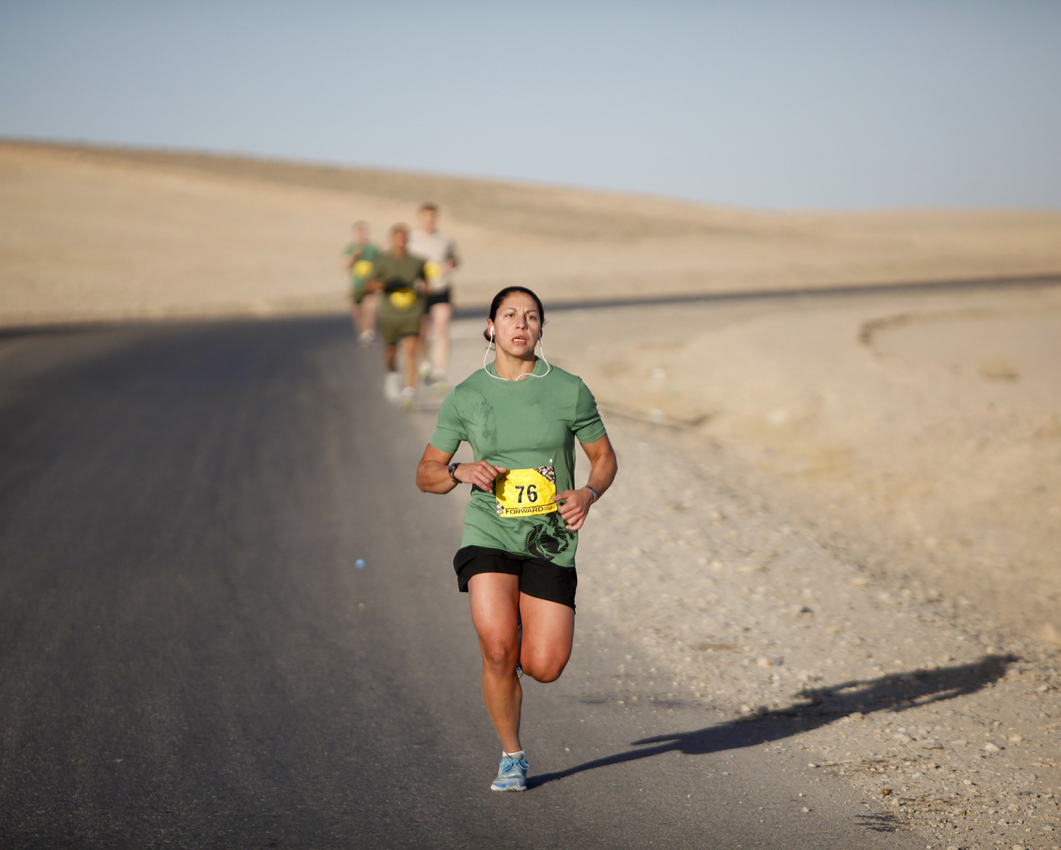 Fit Woman Running in Marathon Competition