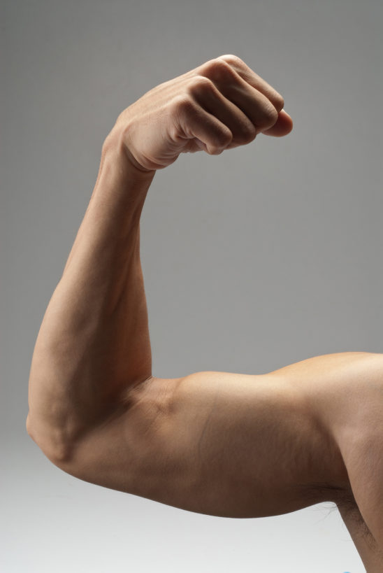 Man Flexing Biceps Muscles