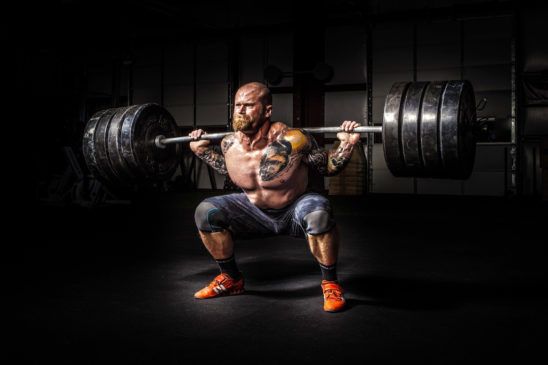 Power Lifter Doing Squats With Heavy Weights