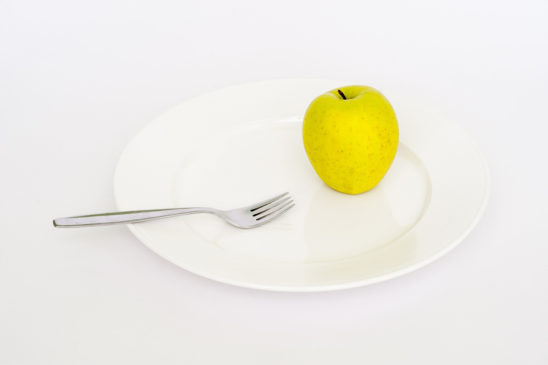 Apple and Folk on A Plate Dieting Concept