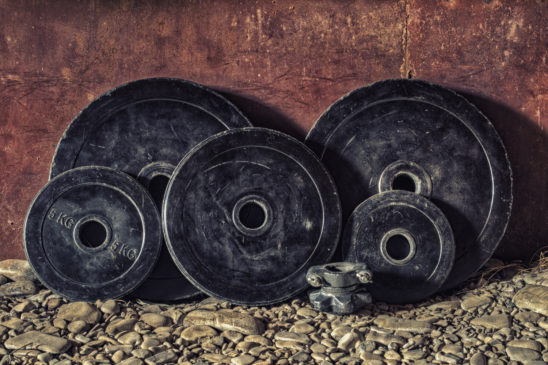Barbell Weights Placed Against The Wall