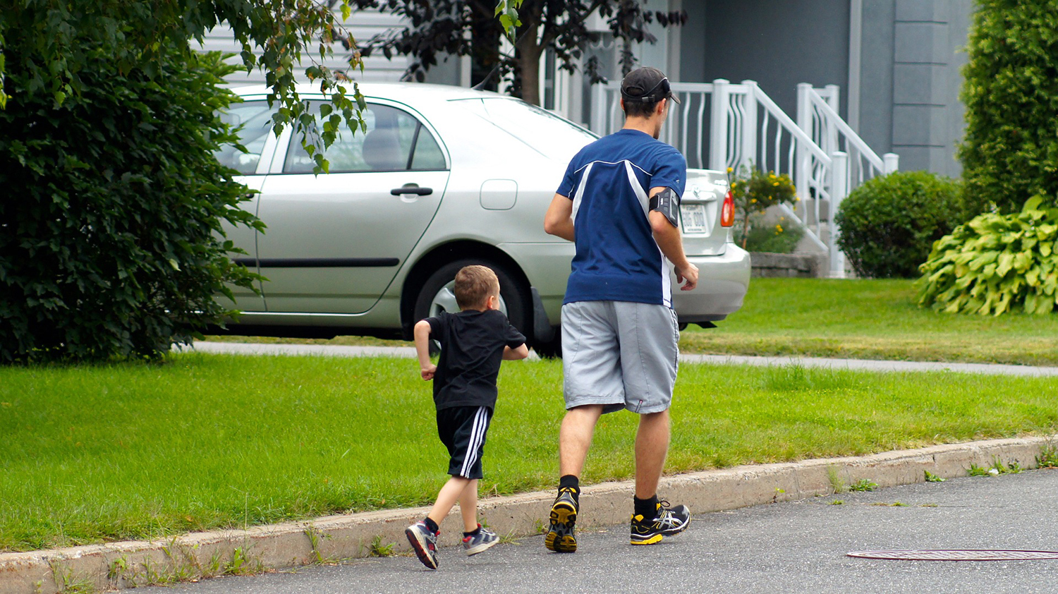 Fitness Man and Young Kid Running